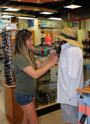 Island Native employee Jessica Tyler works on a clothing display. (VBR)