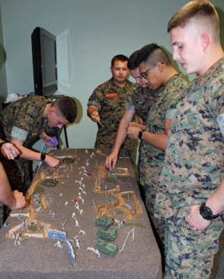 Cadets in a military history class work on a diorama depicting a World War I battlefield. (VBR)