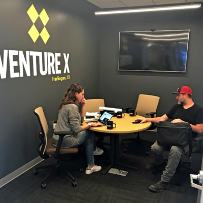 Two Venture X clients take care of business in one of the meeting rooms. (Courtesy)