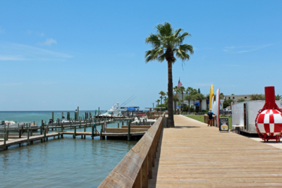 A boardwalk now overlooks the expanded boat facilities at the renovated Jim's Pier on the Laguna Madre. (VBR)