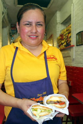 Mayra Islas gets ready to service a couple of burgers at Rutledge Hamburgers. (VBR)