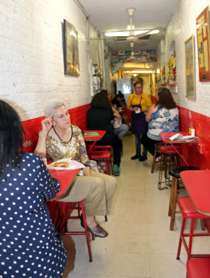 Patrons gather at Rutledge Hamburgers, known by some as pasillo, or little aisle, for its narrow dining area. (VBR)