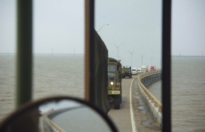 A Texas task force convoy crosses a two-mile bridge after Hurricane Dolly made landfall at South Padre Island in 2008. (U.S. Air Force photo/Staff Sgt. Bennie J. Davis III)