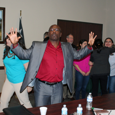 Chris'mere Mallard pumps up participants during group activities at a sales seminar in Weslaco. (VBR)