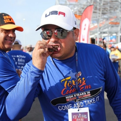 Edinburg Chamber of Commerce Chairman of the Board Alex Rios samples a piece of rib-eye steak at the 2017 Texas State Championship Cook-off in Edinburg. (photo Edinburg Chamber)