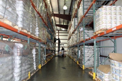 A warehouse is filled with raw materials used to process into finished products. (VBR)
