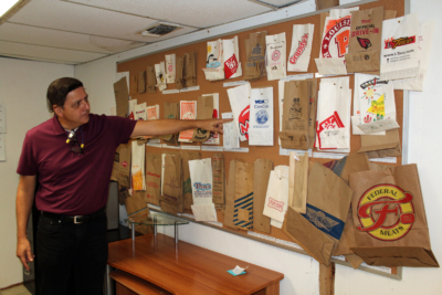 Duro Bag operations manager Carlos Vela shows some of the many paper bags the company produces for restaurants and other businesses. (VBR)