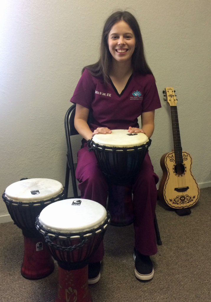 Board certified Music Therapist Marisa de Leon, who plays a wide range of instruments, helps patients regain their ability to walk, move, remember and talk. (VBR)