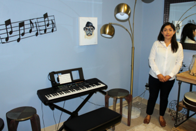 Joanna Ortiz-Gomez, a licensed master social worker, in a room where children use music to help cope with grief. (VBR)