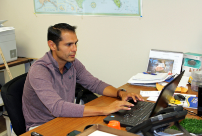 SPI Nets owner Joe Rodriguez works at his desk in the company's San Benito office. (VBR)