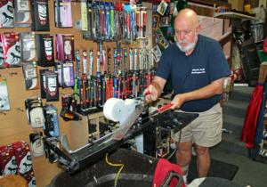 Elliott's Custom Golf owner Tim Elliott replaces the grip on a customer's golf club. (VBR)