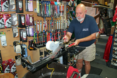 Elliott's Custom Golf owner Tim Elliott replaces the grip on a customer's golf club. (VBR)