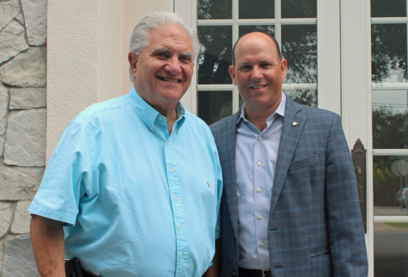 Michael Blum and Edward Villarreal in front of their new McAllen office following the merger of their commercial real estate companies. (VBR)