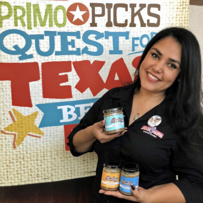 Nuts and Cows owner Elizabeth Davis with products she pitched in the H-E-B Quest for Texas Best competition. (Courtesy)