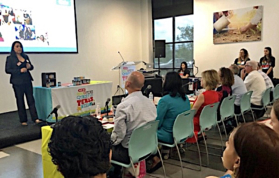 Elizabeth Davis makes her presentation of Nuts and Cows products to H-E-B executives. (Courtesy)