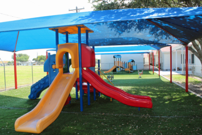 Multiple canopies cover playground equipment to protect schoolchildren at Covenant Christian Academy. (VBR)