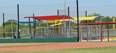 Tenzo shade structures offer multi-colored sun protection over bleachers at the McAllen Youth Baseball Complex. (VBR)