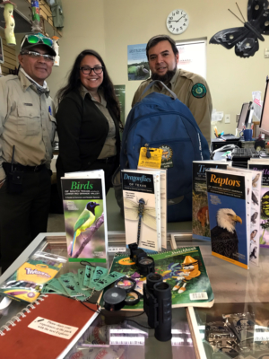 Estero Llano Grande State Park staff display the contents of a daypack that families can borrow while visiting the park. (VBR)
