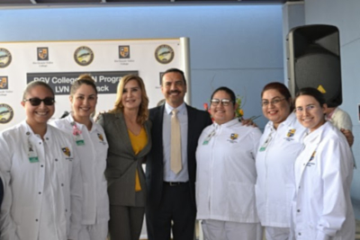 Mayor Ambrosio Hernandez, M.D. and Dr. Annabelle Palomo celebrate alongside current RGV College nursing students.
