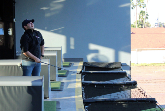 A player at Topgolf in Pharr reacts to one of his shots. (VBR)
