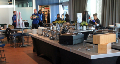 A crew sets up for a catered event hosted by the City of Pharr in Topgolf's large event room. (VBR)