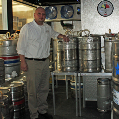 Manager Kevin Norrell inside the glass-enclosed keg storage area at the Yard House in McAllen. (VBR)