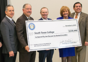 The Economic Development Corporation of McAllen presents South Texas College with a job-training grant to provide customized training related to advanced manufacturing within the city's boundaries.
