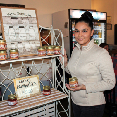 Rebecca Garcia with jars of Blanquita's Salsa made using her grandmother's recipes. (VBR)
