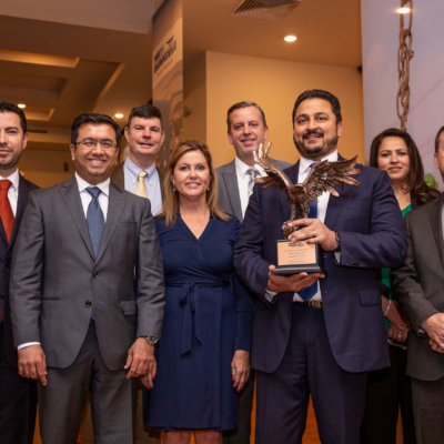 CEO of West Plains LLC Amit Bhandari (third from right) accepts the 2018 Chairman's Award with company representatives.