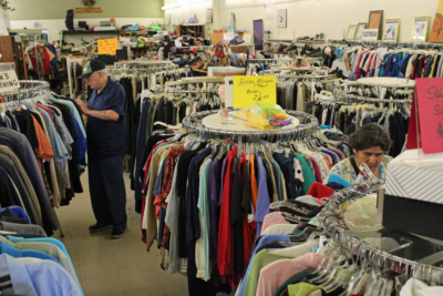 Customers browse racks of used clothing at Repeat Performance, which is open Monday through Saturday on Jackson Street in Harlingen. (VBR)