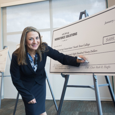 Ruth Hughs, chair of Texas Workforce Commission, signs three grants totaling more than $1.3 million to South Texas College. (photo STC)