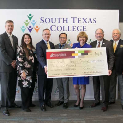 South Texas College and South Texas Health System host a check presentation Jan. 10. Funds will provide scholarships to Nursing and Allied Health Students at the college. (photo STC)