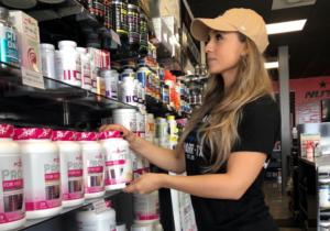 Sally Balderas Bracewell helps a customer at one of All Star Nutrition's three Rio Grande Valley stores. (VBR)
