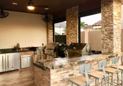 A variety of equipment, including refrigerators and a bar top with stools, highlight a Grill Street design. (Courtesy)