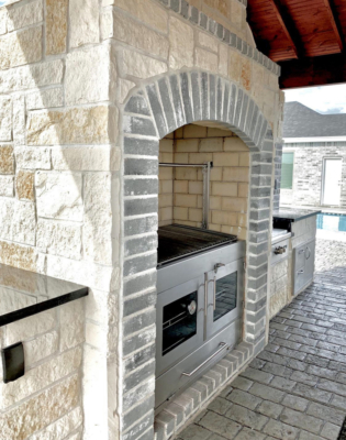 Extensive brick work is central to this outdoor kitchen design by Grill Street. (Courtesy)