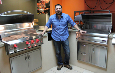 Grill Street owner Ruben Castillo stands next to a display of outdoor kitchen design in his McAllen showroom. (VBR)