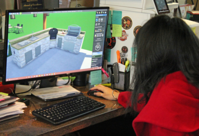 An architect with Grill Street works on a computer-generated 3-D design for an outdoor kitchen. (VBR)