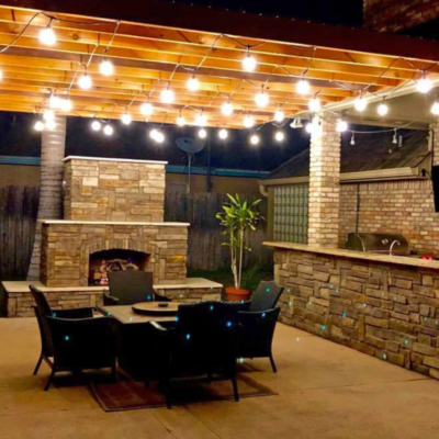 An outdoor kitchen and entertainment area with fireplace designed and installed by Grill Street. (Courtesy)