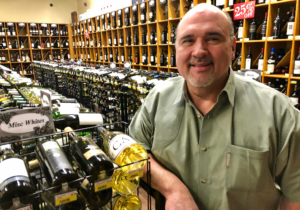 To stay competitive, Holiday Wine and Liquor owner David Hernandez's Rio Grande Valley business evolved from selling cold beer to a chain of full-service liquor stores. (VBR)