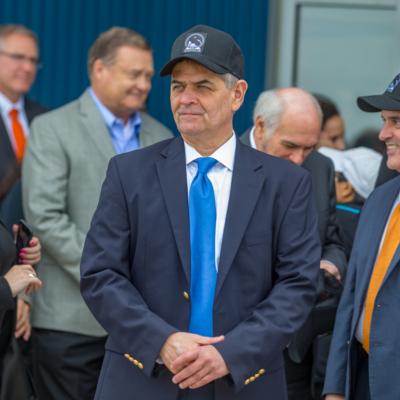 U.S. Congressman Filemon Vela, center, stands with UT Regent Ernest Aliseda. (David Pike)