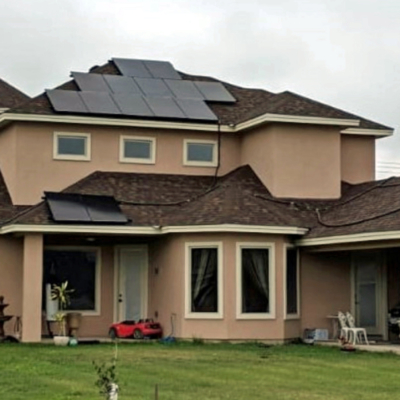 A solar roof installation on a building detached from the residence helps power an entire home in Mission. (VBR)