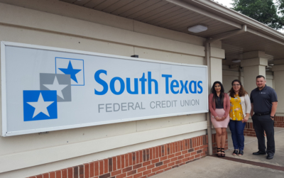 Laura Espinoza of the Weslaco Chamber of Commerce, center, with South Texas Federal Credit Union representatives Jessica Marin and Cesar Leal