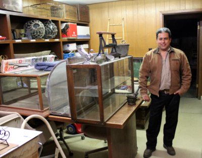 Ruben Balboa with furniture and other items stored in Balboa Auction Company's new location in downtown San Benito. (VBR)