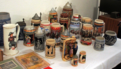 Collectible beer steins on display prior to the start of an auction at Balboa Auction Company (VBR)