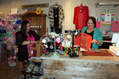 Owner Elma Chavez and her daughter Crissy Santana sort a shipment of new merchandise, some of which will be featured on a social media live streaming promotion. (VBR)