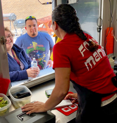 Connie Chavirra chats with customers as she takes their order at Food Mania Tampico Style food truck. (VBR)