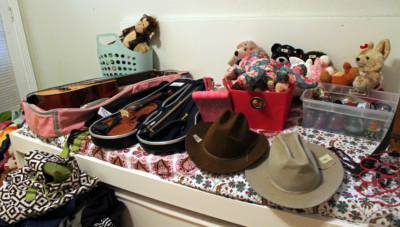 From cowboy hats to musical instruments to stuffed animals, items can vary widely at estate sales. (VBR)