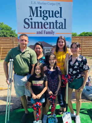 Marine Corporal and his family at a groundbreaking ceremony for his new home made possible by donations from various businesses. (Oskar Hernandez)