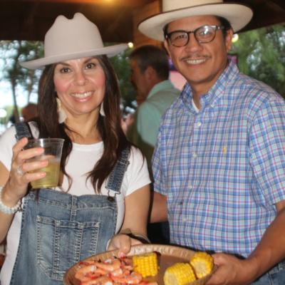Fundraiser attendees hold a plate of shrimp during Las Huellas' Crawfish and Shrimp Boil fundraiser. (VBR)