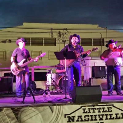 A country-western band performs as a recent Little Nashville event in Mercedes. (Courtesy)
